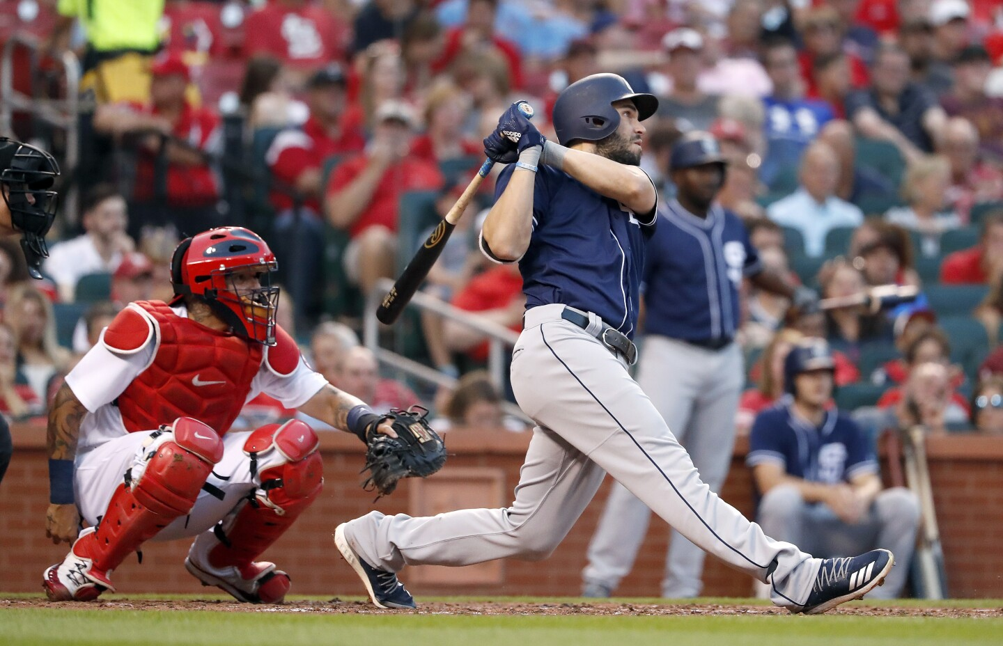 San Diego Padres' Eric Hosmer watches his solo home run in front of St. Louis Cardinals catcher Yadier Molina during the fourth inning of a baseball game Tuesday, June 12, 2018, in St. Louis. (AP Photo/Jeff Roberson)
