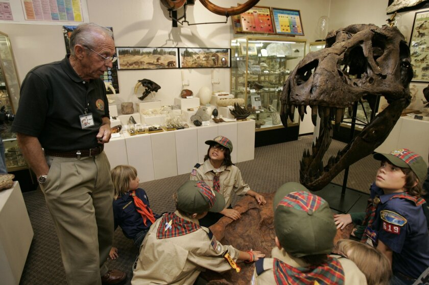 Paleontologist Keith Roynon, instructing visiting Cub Scout Pack 619, enjoys sharing his personal collection of rare rocks and fossils so much so that he has converted his home into a museum to display them for visitors.