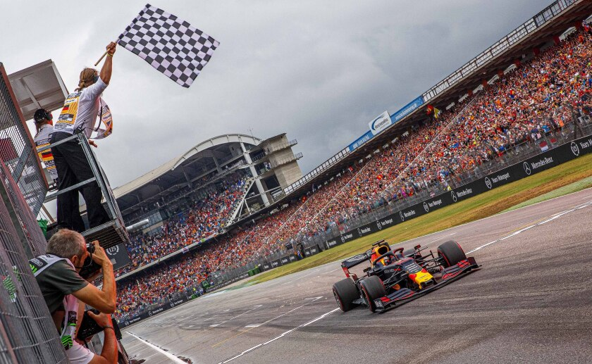 Max Verstappen crosses the finish line to win the German Grand Prix on Sunday.