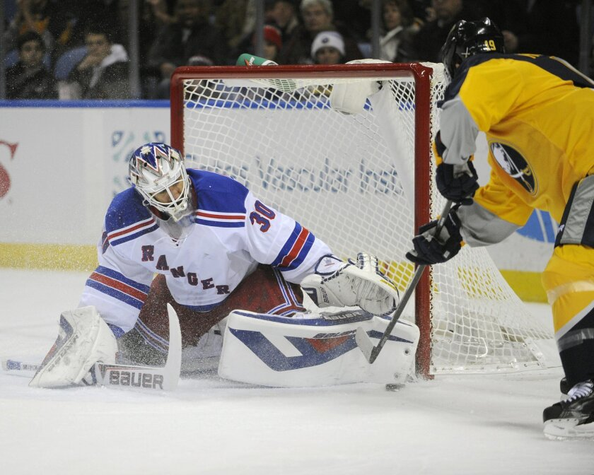 New York Rangers goaltender Henrik Lundqvist (30), of Sweden, stops Buffalo Sabres center Cody Hodgson, right, during the first period of an NHL hockey game in Buffalo, N.Y., Thursday, Dec. 5, 2013. (AP Photo/Gary Wiepert)