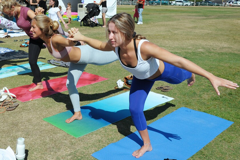 Yogis got their downward dog on at the One Love Movement's 8th Annual Charity Yoga & Live Music Event at Waterfront Park on Saturday, Sept. 21, 2019.