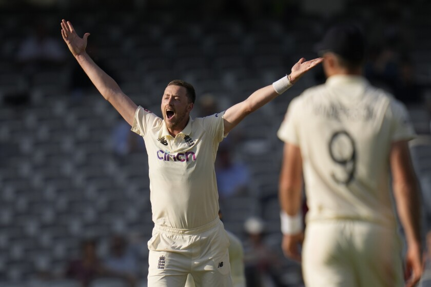 England's Ollie Robinson appeals for lbw the wicket of New Zealand's Kane Williamson during the fourth day of the Test match between England and New Zealand at Lord's cricket ground in London, Saturday, June 5, 2021. (AP Photo/Kirsty Wigglesworth)