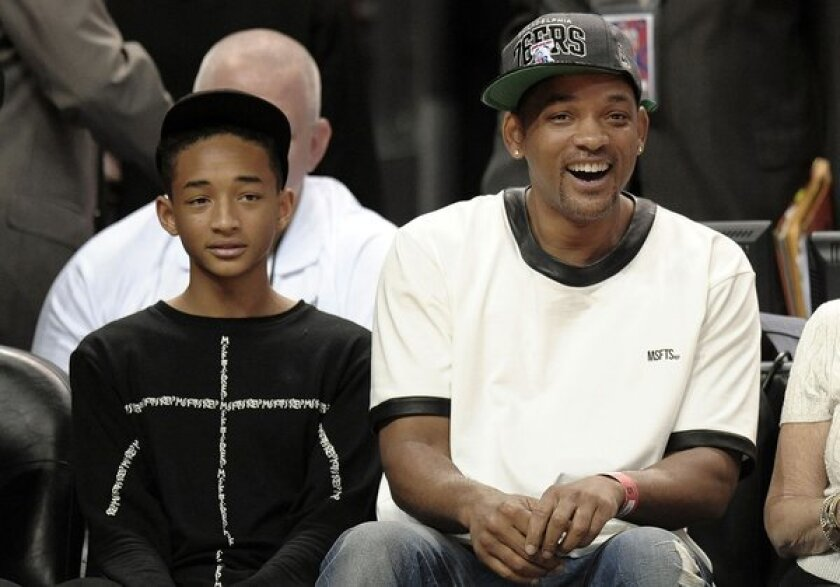 Will Smith and son Jaden get photo-bombed during Game 5 of the NBA Easter Conference Playoffs in Miami.