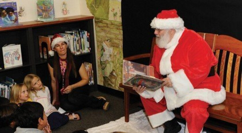 "Santa reads ""'Twas The Night Before Christmas"" to the children. Photo: Jon Clark"