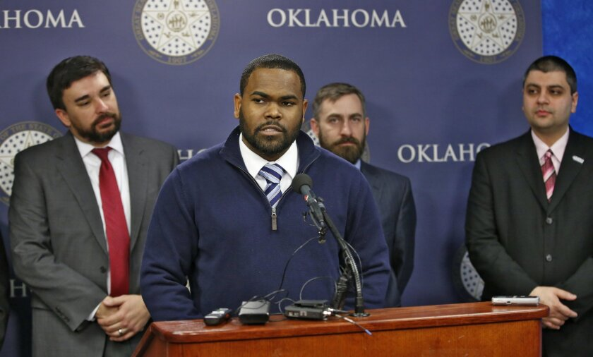 Raja'ee Fatihah speaks to members of the media at the state Capitol in Oklahoma City, Wednesday, Feb.  17, 2016. Fatihah, a U.S. Army reservist, who was asked to leave a gun range in Oklahoma after identifying himself as a Muslim is suing the owners in federal court, pushing back against what he sa