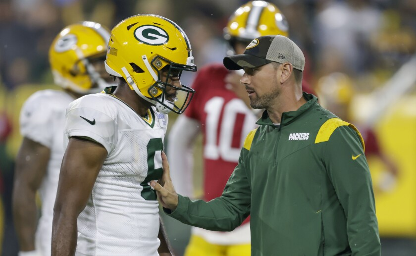 Green Bay Packers head coach Matt LaFleur, right, talks with wide receiver DeAndre Thompkins during an NFL football training camp at Lambeau Field Saturday, Aug. 7, 2021, in Green Bay, Wis. (AP Photo/Matt Ludtke)