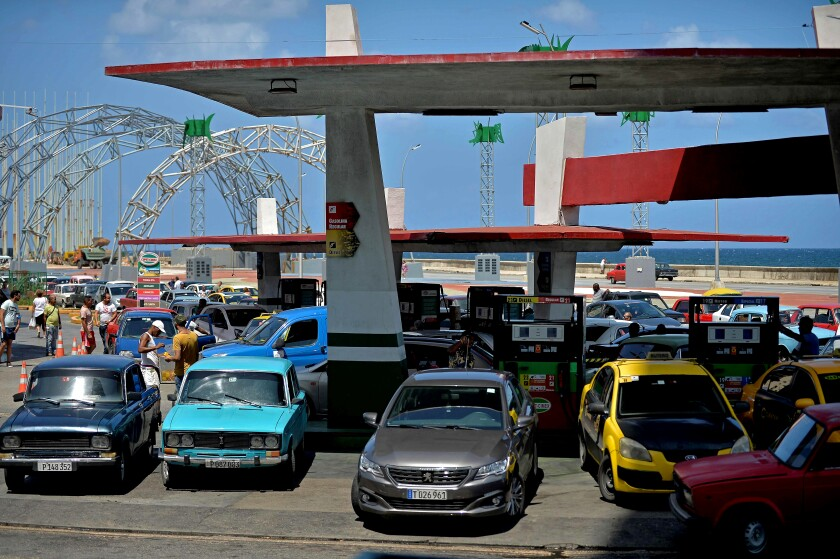 Car drivers line up to get their tanks filled at a gas station in Havana on Sept. 19.