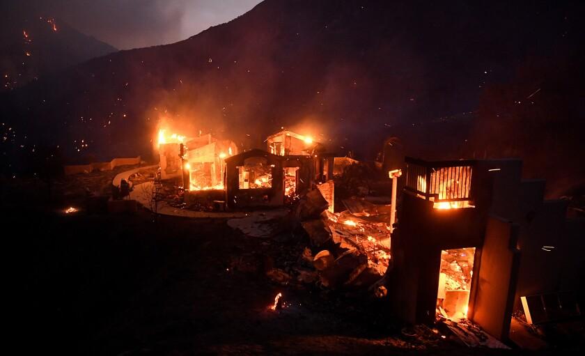 A house burns along Little Tujunga Canyon Road as the Sand fire rages near Santa Clarita.