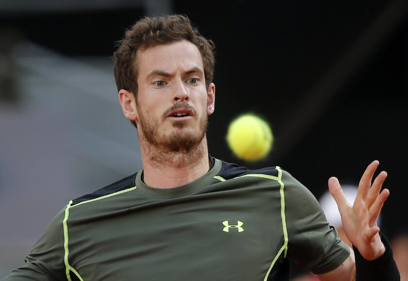 Andy Murray of Britain eyes the ball before returning to Rafael Nadal of Spain during the men's final at the Madrid Open Tennis tournament in Madrid, Spain, Sunday, May 10, 2015. (AP Photo/Paul White)
