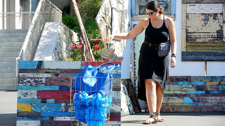Designer Vanessa De Vargas shops the Rose Bowl Flea Market. De Vargas brings a vintage cart and large IKEA bags to carry her purchases.