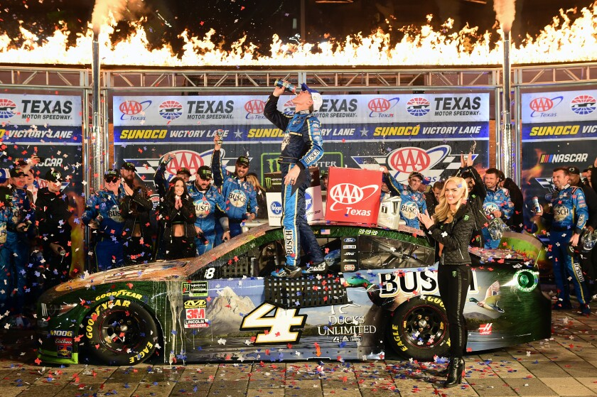 Kevin Harvick celebrates in victory lane after winning Sunday's NASCAR Cup race at Texas Motor Speedway.