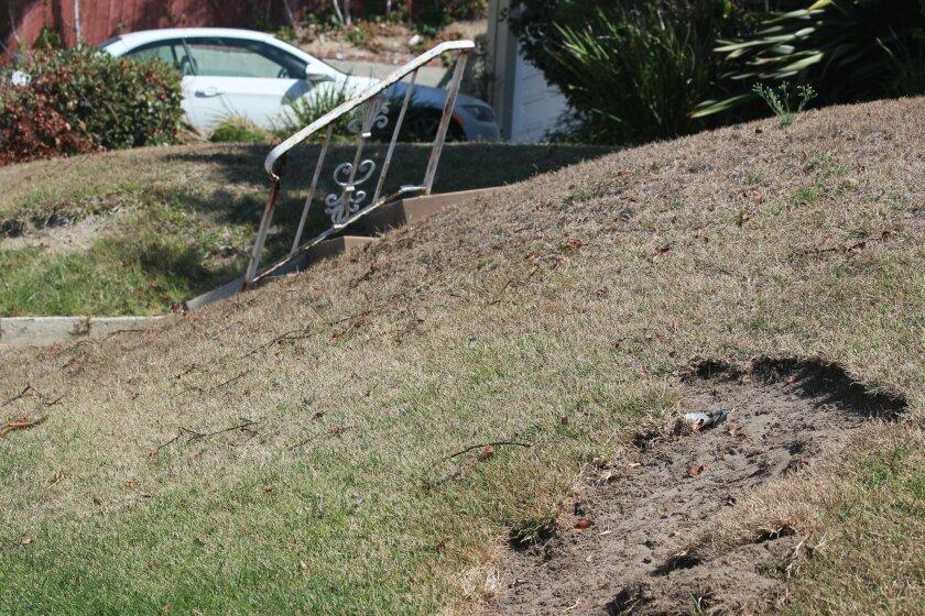 Damage to a yard at Nautilus Street and Avenida la Reina sustained during the crash.
