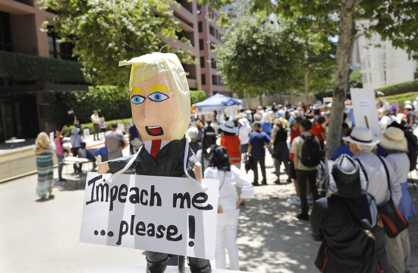 A rally held at noon at San Diego Federal Courthouse encouraged San Diego congressional representatives to open an impeachment inquiry hoping to move forward impeachment proceedings against President Trump.