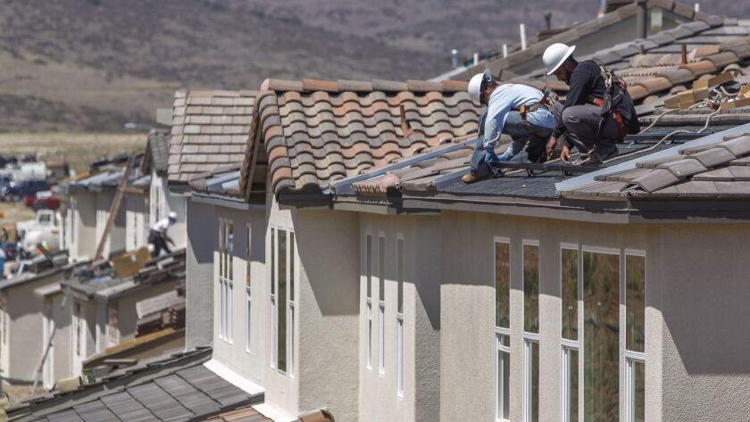 SANTEE, May 8, 2018 | Juan Ortega, left, and Edgard Ojeda, both solar panel installers for Californi