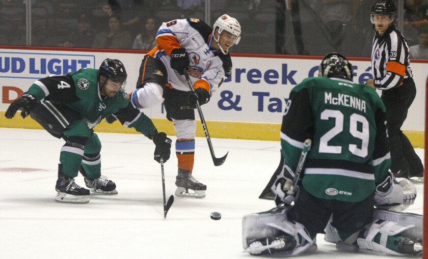 The Gulls' Kevin Roy takes a shot at the goal, guarded by Texas Stars' goalie Mike McKenna during the third period at the Valley View Casino Center.