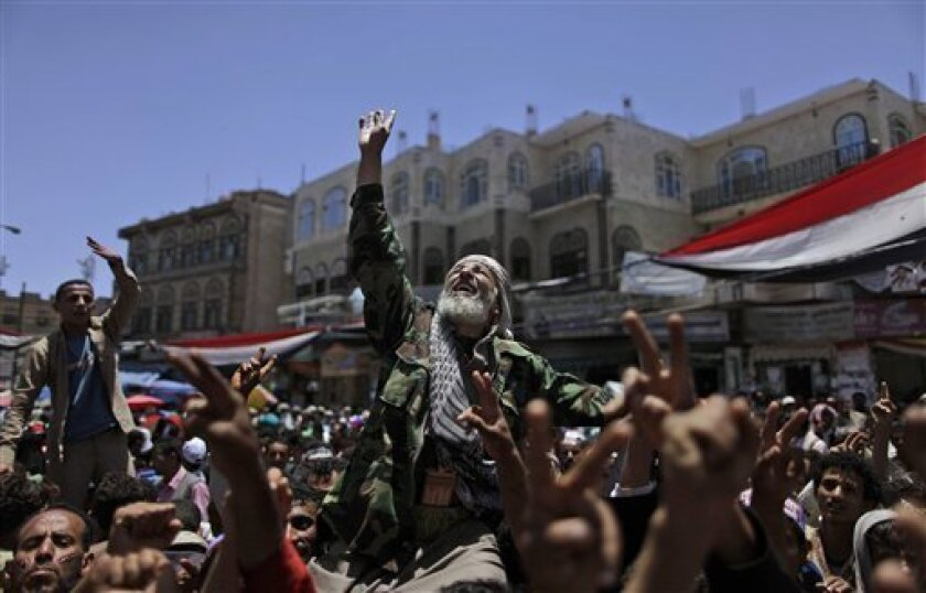 An elderly anti-government protestor, center, carried on the shoulders of other demonstrators, reacts during a demonstration demanding the resignation of Yemeni President Ali Abdullah Saleh, in Sanaa,Yemen, Saturday, April 30, 2011. Eyewitnesses said Yemeni forces stormed the main square in a southern Yemeni city to forcibly evict a two-month-old encampment of 1,500 anti-government protesters. (AP Photo/Muhammed Muheisen)