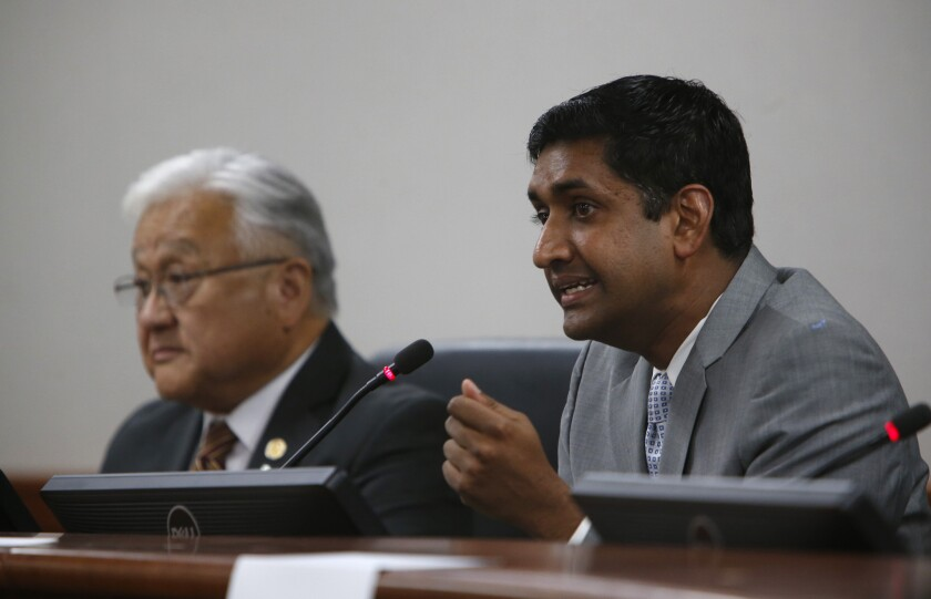 Democrat Ro Khanna, right, speaks a 2014 candidates forum with Rep. Mike Honda (D-San Jose). Khanna is challenging Honda again this year.