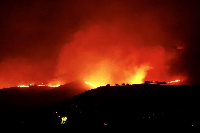 A hillside burns during the Woolsey fire