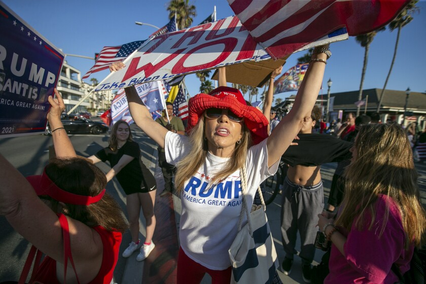 """Trump supporters gather for an anti-mask """"freedom march"""" in Huntington Beach on Monday, June 14."""