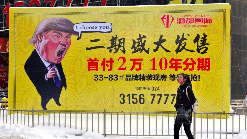 A real estate billboard in Shenyang in northeastern China on Feb. 22, 2017, features a cartoon figure resembling President Trump.