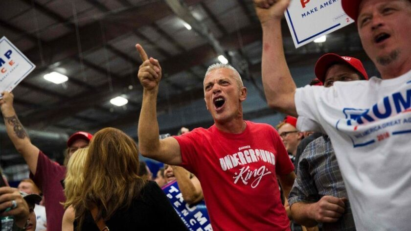 A supporter of Republican presidential candidate Donald Trump jeers at the media at a rally in Newtown, Pennsylvania on October 21, 2016.