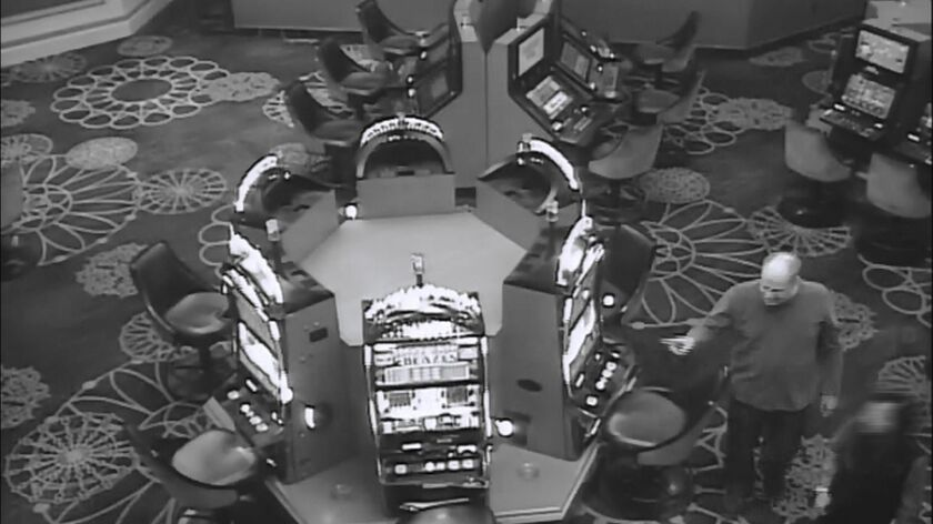In this Oct. 1, 2017, security camera image released by MGM Resorts, is Stephen Paddock walking thro