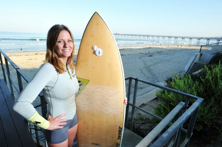 Nicole Dodson's getting ready to ride the waves at Scripps Pier, La Jolla.