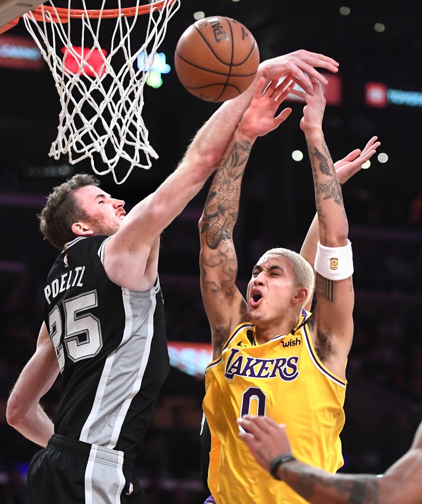 Kyle Kuzma is fouled by the Spurs' Jakob Poeltl while driving to the basket during the fourth quarter of a game Feb. 4 at Staples Center.