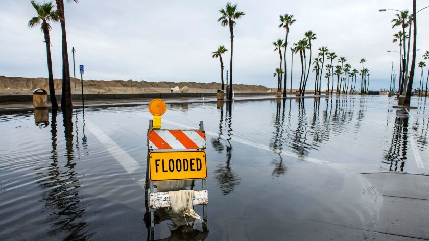 A sign lets visitors know that this beach-side parking lot near the Balboa Pier in Newport Beach, Ca