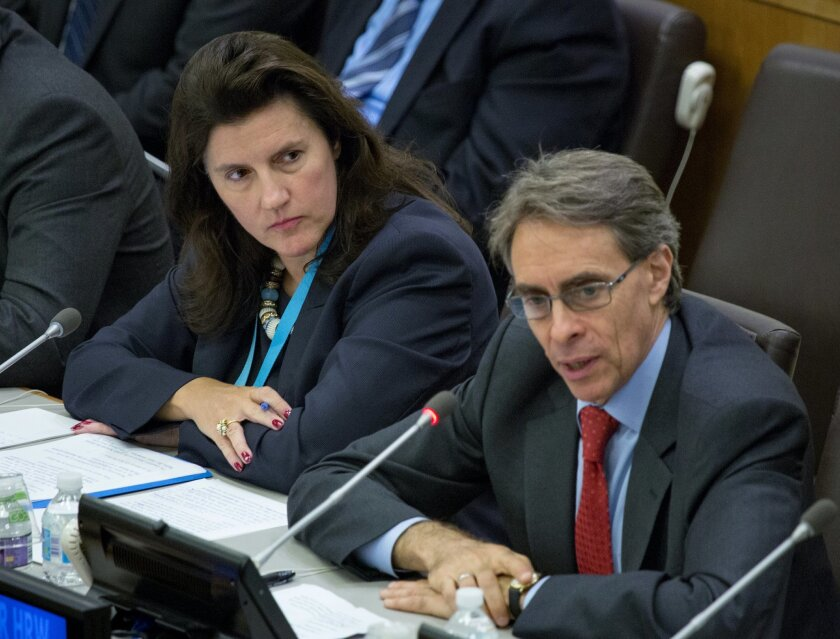 Sylvie Lucas, Luxembourg's ambassador to the United Nations, left, listens to Kenneth Roth, executive director of Human Rights Watch, right, during a high-level event surrounding the Syrian refugee crisis and the toll of indiscriminate weapons during the 70th session of the United Nations General Assembly at U.N. headquarters, Monday, Sept. 28, 2015. (AP Photo/Craig Ruttle)