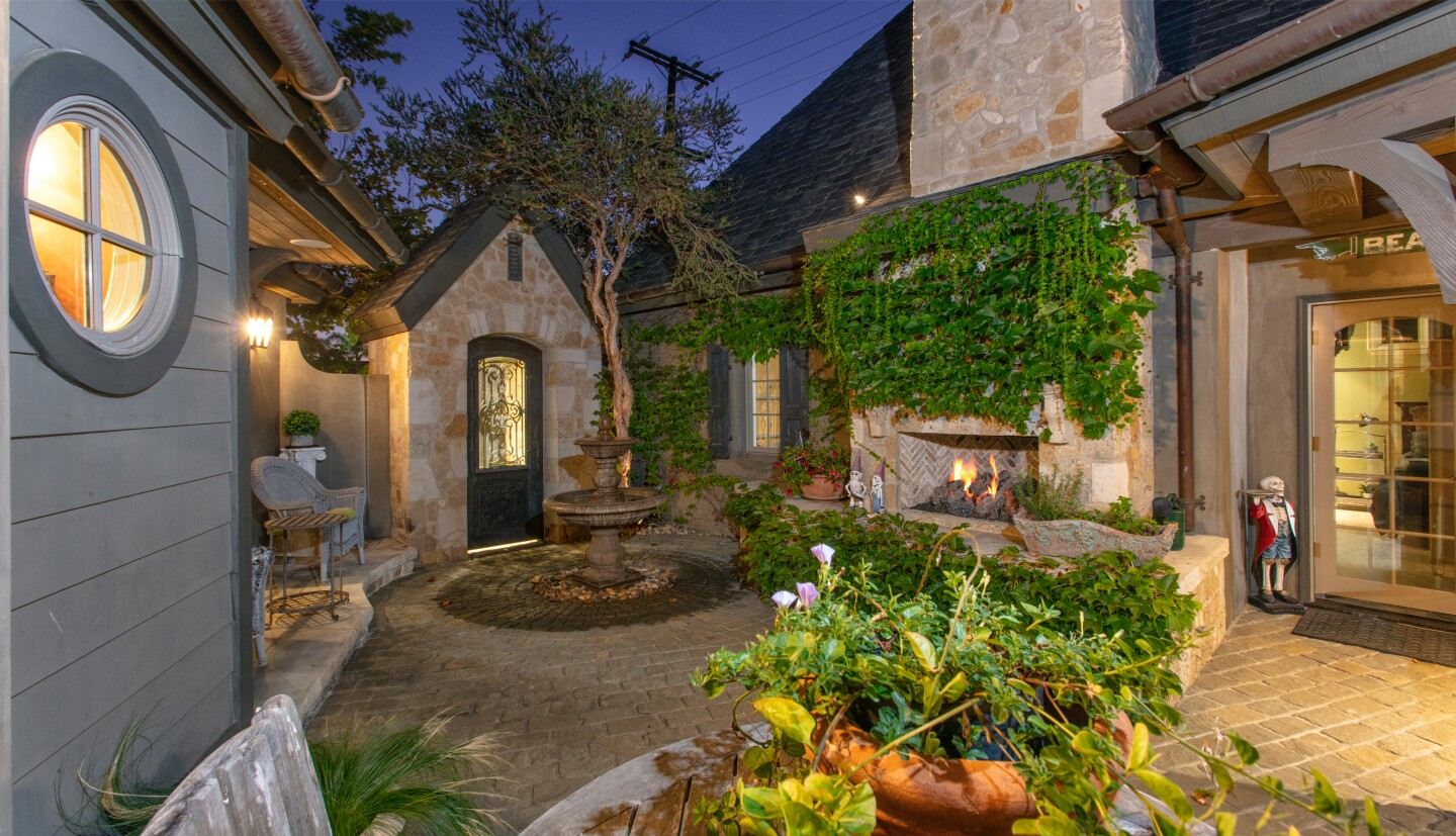 Set on a quarter of an acre, the custom home features French Normandy vibes with a stone exterior and steep pitched roof.