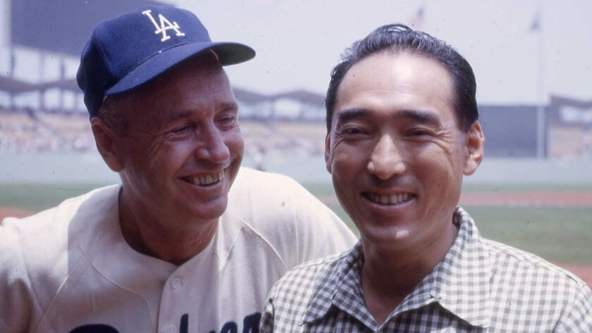 1964 photo of Dodgers manager, Walt Alston and clubhouse man, Nobe Kawano.