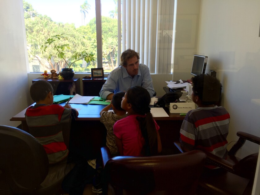 An attorney with Casa Cornelia meets with unaccompanied minors.