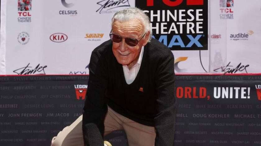 Stan Lee, the iconic creator and legend of Marvel Comics, puts his handprints and footprints in cement at the TCL Chinese Theatre IMAX on July 18, 2017.