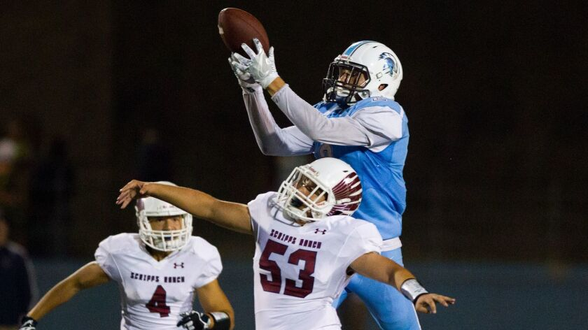 University City wide receiver Casey Granfors makes a catch over top of linebacker Daniel Sanders.