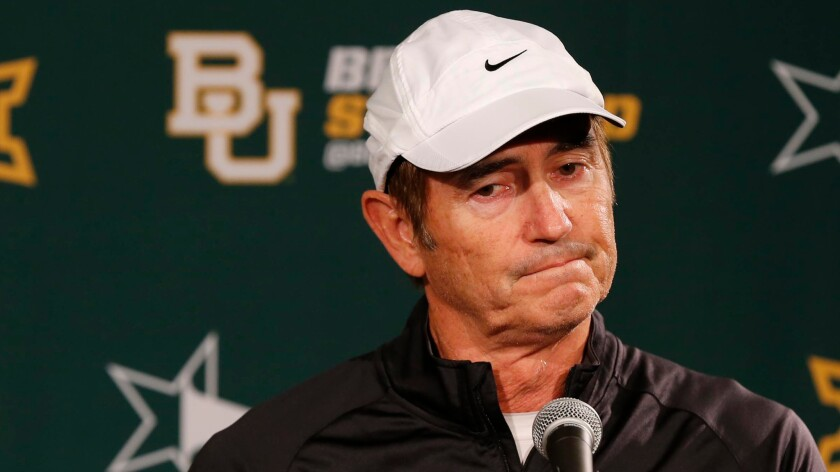 Art Briles responds to questions during a news conference on Dec. 7, 2014.