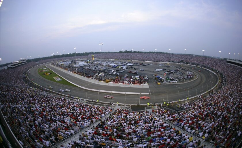 FILE - On this May 14, 2005 file photo, fans pack the stands during the Chevy American Revolution 400 NASCAR auto race at Richmond International Raceway in Richmond, Va. At the zenith of its popularity a decade or so ago, many NASCAR tracks could count on sellout crowds for every Sprint Cup Series