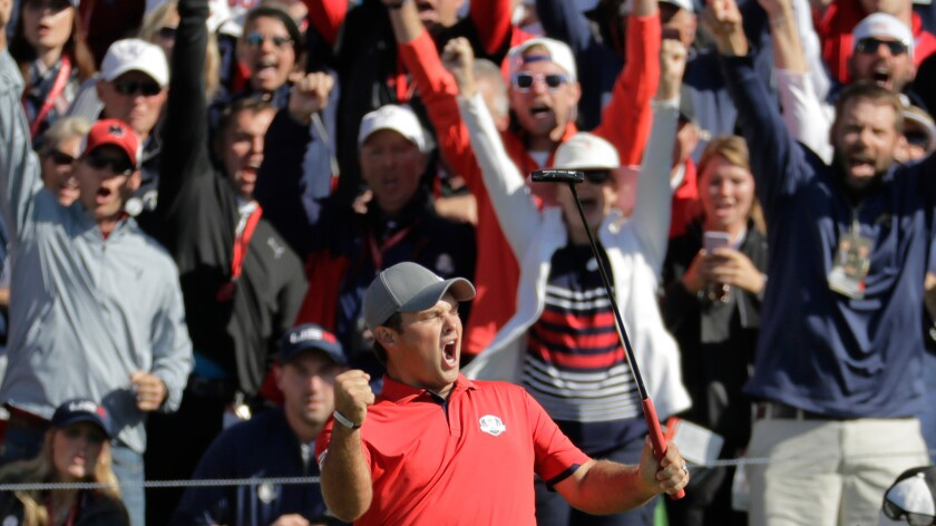 U.S. golfer Patrick Reed celebrates after making a match-winning putt during the first round of the Ryder Cup at Hazeltine National in Minnesota.