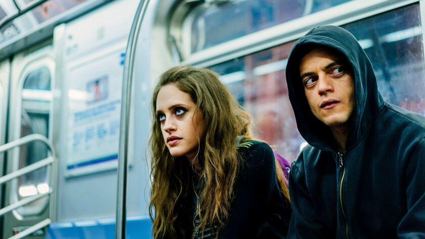 "Carly Chaikin and Rami Malek in ""Mr. Robot."""