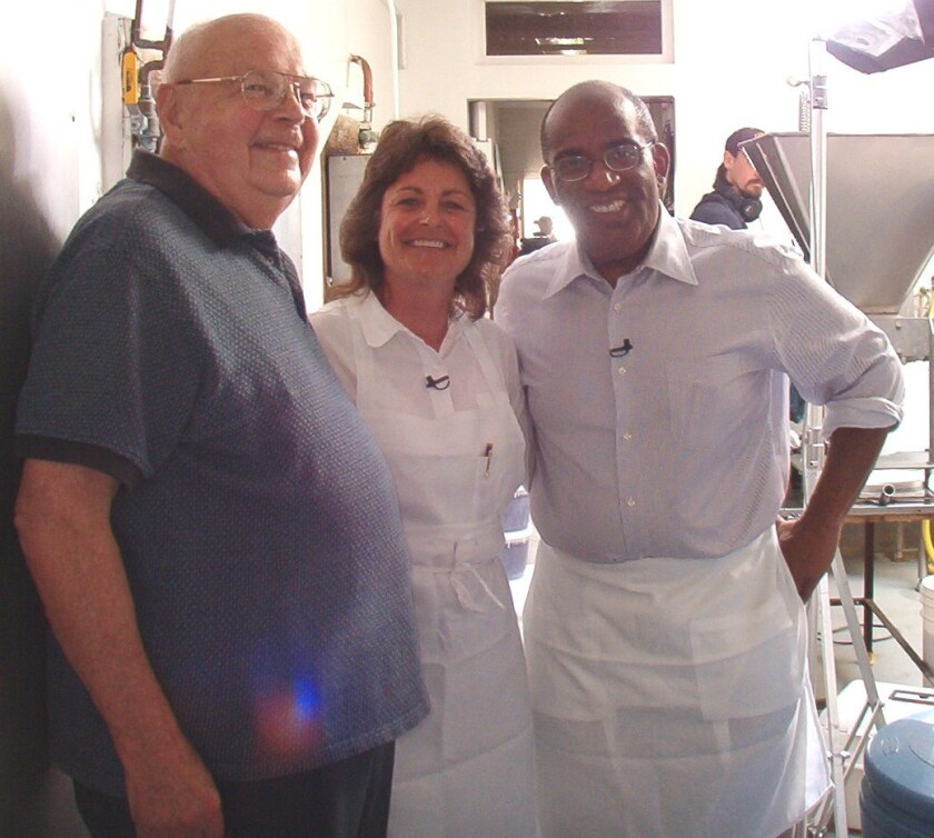 "Ed Niederfrank and Patti Finnegan with Al Roker filming an episode of ""Roker on the Road"" for the Food Network."