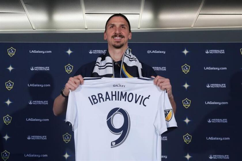 Zlatan Ibrahimovic poses with his jersey at a press conference introducing him as a member of the LA Galaxy in Carson, California, USA, 30 March 2018. EFE