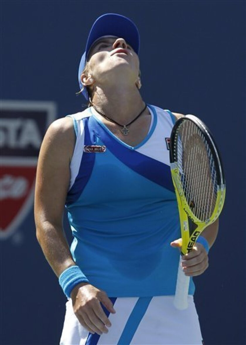 Svetlana Kuznetsova of Russia reacts to losing a point to Dominika Cibulkova of Slovakia in the fourth round of play at the U.S. Open tennis tournament in New York, Monday, Sept. 6, 2010. (AP Photo/Kathy Willens)