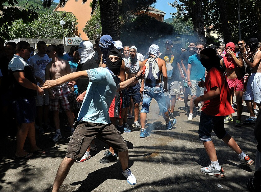 A protester attacks a march by gay rights activists in the Montenegrin coastal resort of Budva. The display of intolerance could harm the former Yugoslav republic's bid to join the European Union.