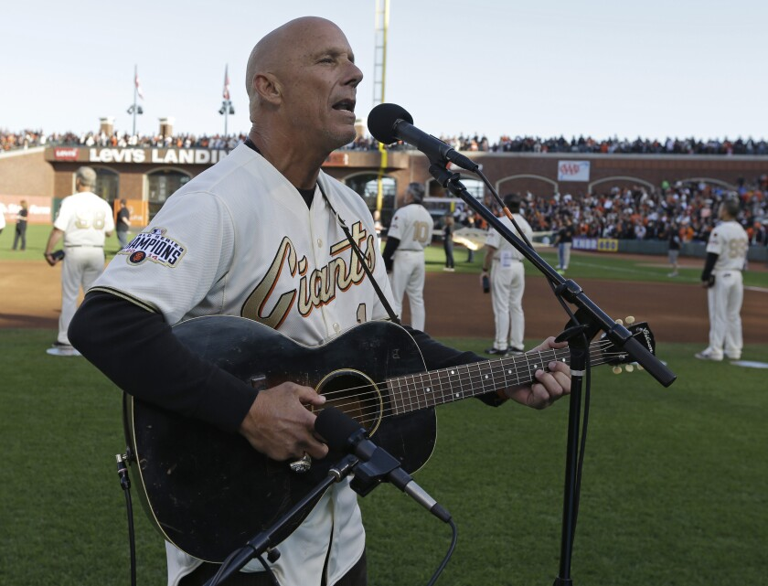 Former Padres infielder and coach Tim Flannery performs national anthem before a San Francisco Giants game in 2015.