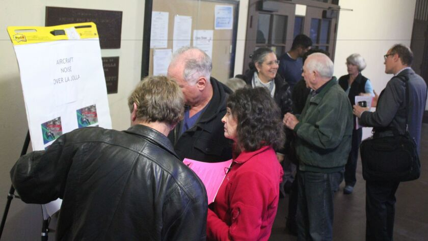 At the La Jolla Town Council meeting, Feb. 9, airplane noise protestors set up a booth to give out information and request signatures for their protest petition.