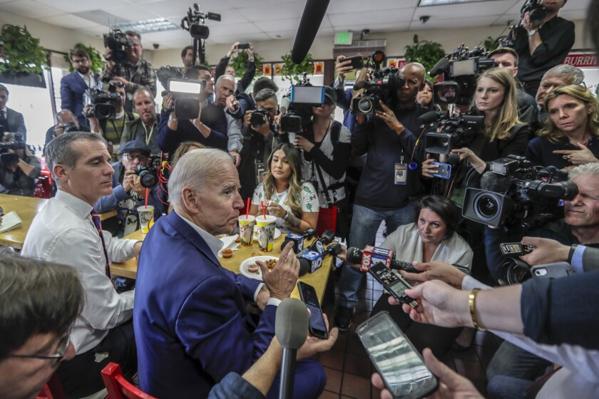 L.A. Mayor Eric Garcetti and Joe Biden speak to members of the media at King Taco amid the Democratic presidential primaries.