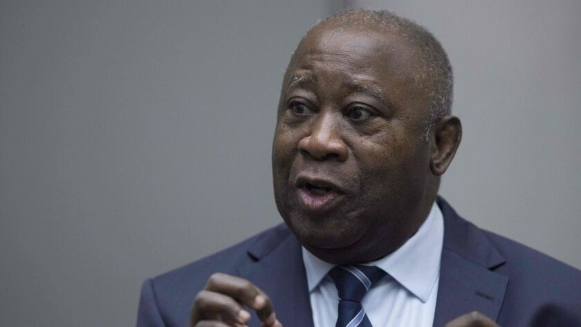 Laurent Gbagbo, former Ivory Coast president, enters International Criminal Court in the Hague. He was the first former president to go on trial at the global court.