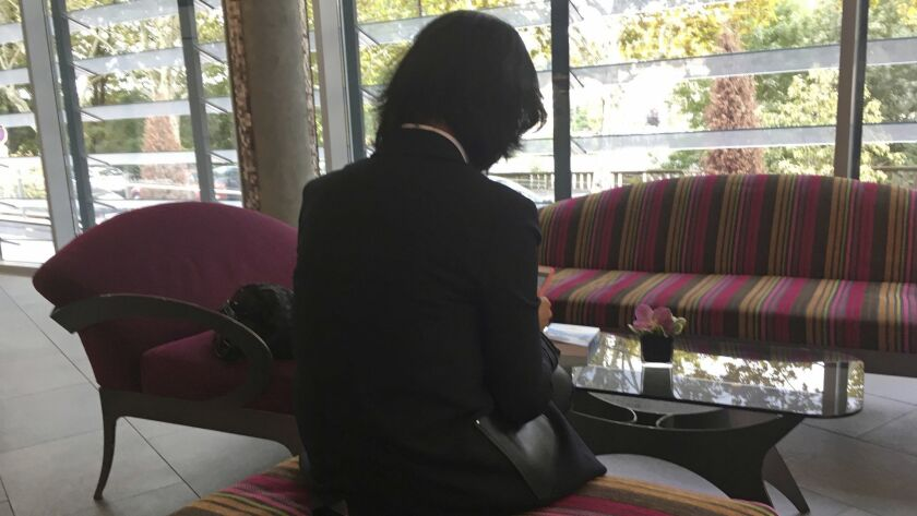 Grace Meng, the wife of missing Interpol President Meng Hongwei, who does not want her face shown, c
