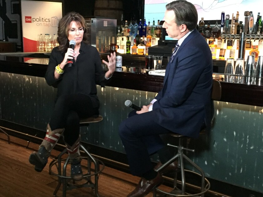 """On Monday, Dec. 14, Sarah Palin chatted with CNN's Jake Tapper at Double Barrel Roadhouse on the Las Vegas Strip to promote her new book, """"Sweet Freedom,"""" a Christian devotional."""