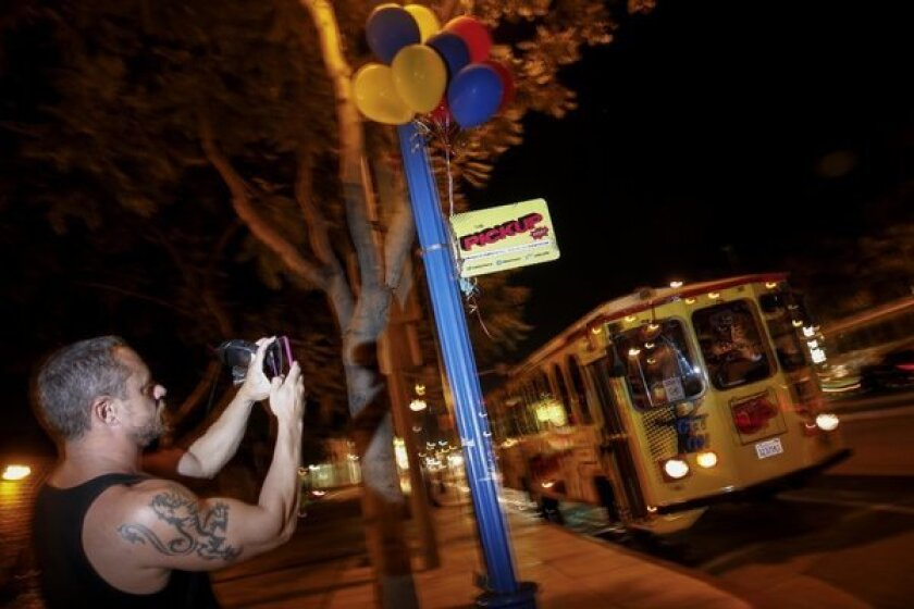 Max Bruce snaps a picture of a PickUp trolley near a stop on Santa Monica Boulevard in West Hollywood.